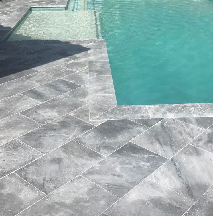 Stoneline-Group-Tahoe-Travertine-Marble-Collection-Marble-Leathered-Coping-Pool-deck-Pictures